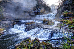 Colorful scenic waterfall in HDR Stock Photography