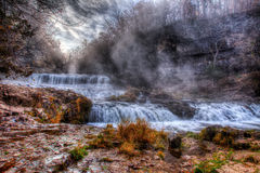 Colorful scenic waterfall in HDR royalty free stock images