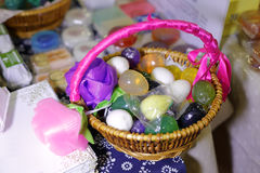 Colorful scented soap in basket Royalty Free Stock Photos