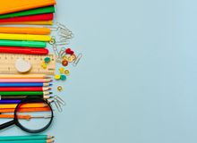 Free Colorful  School Suplies Against Light Blue Background. Stock Image - 152360601