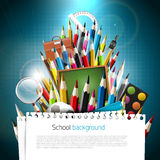 Colorful school supplies. Colorful crayons with school supplies on blue background Stock Image