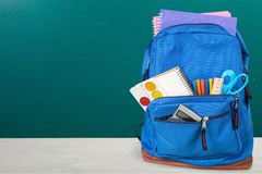 Colorful school supplies  in backpack on. Back school backpack back to school art objects school background color Royalty Free Stock Photo