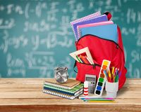 Colorful school supplies  in backpack on. Back school backpack back to school art objects school background color Stock Photography