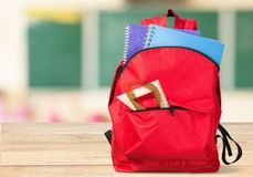Colorful school supplies  in backpack on. Back school backpack back to school art objects school background color Stock Image