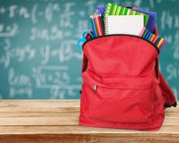 Colorful school supplies  in backpack on. Back school backpack back to school art objects school background color Stock Photo