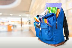 Colorful school supplies in backpack on blurred. Back school backpack back to school art objects school background color Royalty Free Stock Image