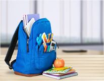 Colorful school supplies in backpack on light. Back school backpack back to school art objects school background color Royalty Free Stock Photography