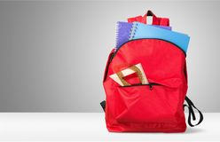 Colorful school supplies in backpack on light. Back school backpack back to school art objects school background color Royalty Free Stock Images