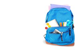Colorful school supplies in backpack on white. Back school backpack back to school art objects school background color Stock Photo