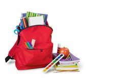 Colorful school supplies in backpack on white. Back school backpack back to school art objects school background color Royalty Free Stock Images
