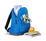 Colorful school supplies in backpack on white. Back school backpack back to school art objects school background color Stock Photos