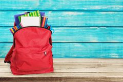 Colorful school supplies in backpack on wooden. Back school backpack back to school art objects school background color Stock Image