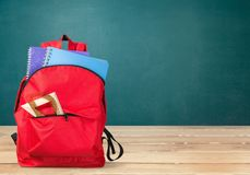 Colorful school supplies in backpack on wooden. Back school backpack back to school art objects school background color Royalty Free Stock Photography