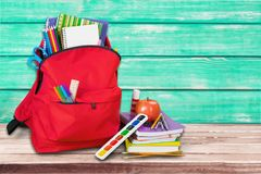 Colorful school supplies in backpack on wooden. Back school backpack back to school art objects school background color Royalty Free Stock Photo