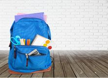Colorful school supplies in backpack on wooden. Back school backpack back to school art objects school background color Stock Images