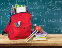 Colorful school supplies in backpack on wooden. Back school backpack back to school art objects school background color Royalty Free Stock Image
