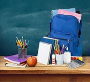 Colorful school supplies in backpack on wooden. Back school backpack back to school art objects school background color Stock Photography