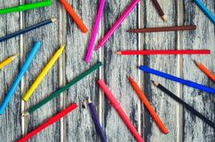 Colorful school supplies. Group of markers and crayons on a wooden table royalty free stock photos