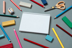 Colorful School Supplies Scattered Around Notebook Royalty Free Stock Images