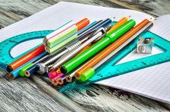 Colorful school supplies. Various equipment for school on a wooden table stock photo