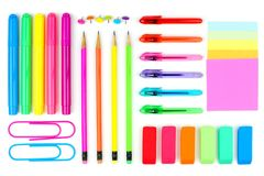 Colorful school supplies on a white background. Above view. Royalty Free Stock Photo