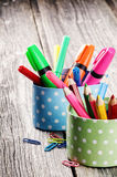 Colorful school supplies on wooden desk Stock Photos