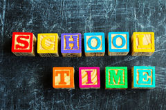 Colorful School Time word from wooden blocks. On the wooden background Royalty Free Stock Photos