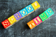 Colorful School Time word from wooden blocks. On the wooden background Royalty Free Stock Images