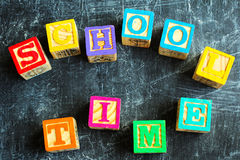 Colorful School Time word from wooden blocks. On the wooden background Royalty Free Stock Photo