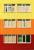 Colorful school wall, and six windows with paper appliqu birds stars Royalty Free Stock Photo