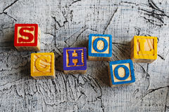 Colorful School word from wooden blocks. On the wooden background Royalty Free Stock Photography