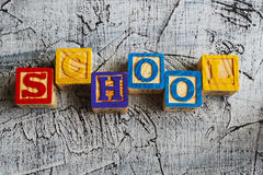 Colorful School word from wooden blocks. On the wooden background Stock Photography