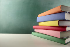 Colorful schoolbooks stock images