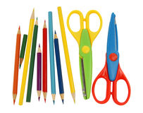 Colorful scissors and colored pencils. Royalty Free Stock Images