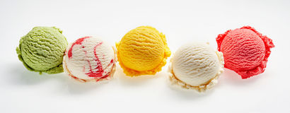 Colorful Scoops of Colorful Ice Cream. High Angle Still Life View of Five Scoops of Colorful and Refreshingly Cool Ice Cream in front of White Background Royalty Free Stock Image