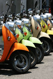 Colorful Scooters. A row of colorful and old styled scooters. These scooters are for hire at a holiday destination royalty free stock image
