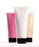Colorful scrubs in tubes on a background Stock Photos
