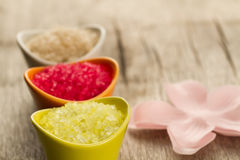 Colorful sea bath salts on wooden background. Stock Photo