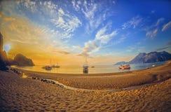 Colorful sea beach sunrise. Panoramic Olympos Beach Stock Photo