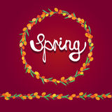 Colorful sea buckthorn wreath with spring lettering inside it Stock Photography
