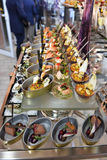 Colorful Sea Food and Pâtés Amuse-Bouches Served on Small Cans, Bite-Sized Food Stock Image