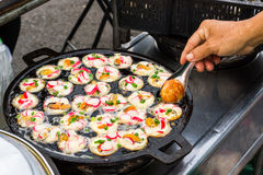 Colorful of seafood fried with shrimps, shellfish on thai ancien Royalty Free Stock Images