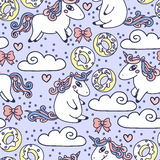 Colorful seamless background with cute doodle unicorns and sweets Stock Images