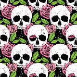 Colorful seamless background with skull, leaf and rose. Colorful seamless vector pattern with white skull, green leaf and pink rose, beautiful background in Royalty Free Stock Photos