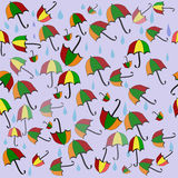 Colorful seamless background with umbrellas and rainy drops. Royalty Free Stock Photos