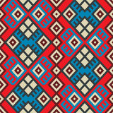 Colorful seamless ethnic pattern. Background in bright blue, red and white colors, vector illustration Royalty Free Stock Images