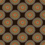 Colorful seamless flower pattern. Boho style doodle background. Brown wallpaper. Stock Image