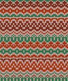 Colorful seamless knitting pattern. Warm traditional texture. Winter wallpaper. Royalty Free Stock Image