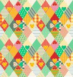 Colorful seamless patchwork pattern with rhombuses and hearts. Stock Photography