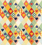 Colorful seamless patchwork pattern with rhombuses and hearts. Royalty Free Stock Images